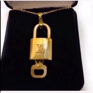 Louis Vuitton lock & key with gold necklace